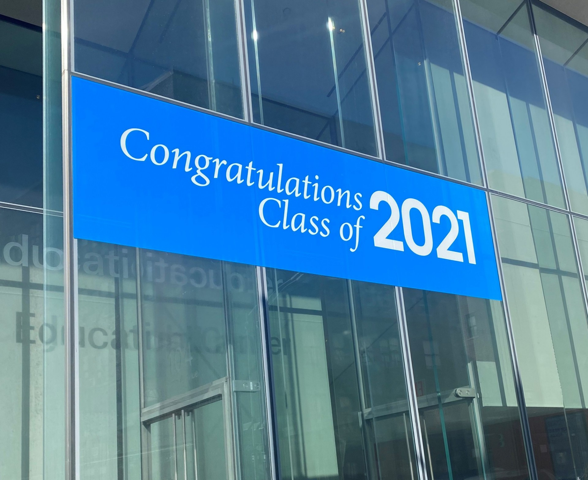 """Congratulations Class of 2021"" graphic on a building window"